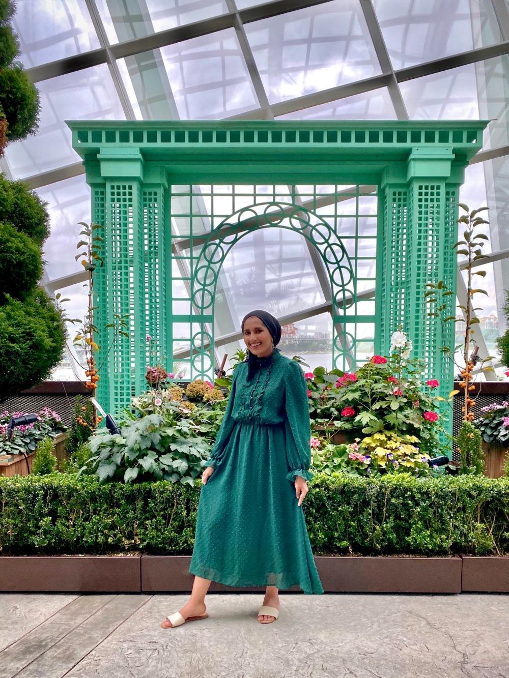 Rafa Farihah in an Emerald Green Dress at Flower Dome Singapore