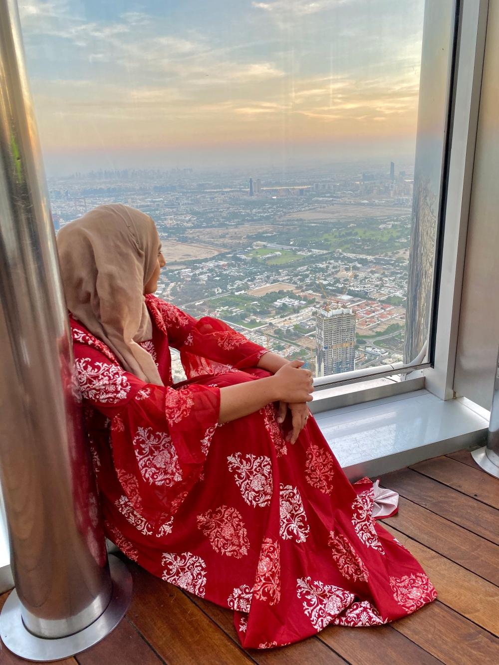 Rafa Farihah Red Maxi Dress Looking at Sunrise Burj Khalifa Dubai